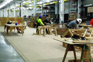 Image of men working inside the Northeast Carpenters Apprenticeship Fund Training Center in Edison