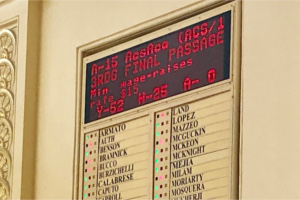 Assembly voting board showing passage of $15 minimum wage bill