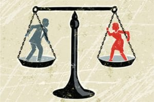 Man-woman on scales of justice