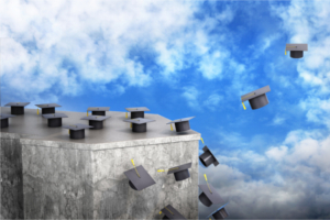 graduation caps flying from a slab of stone into the air.