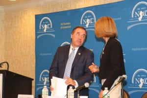 Assembly Speaker Craig Coughlin with NJBIA President and CEO Michele Siekerka