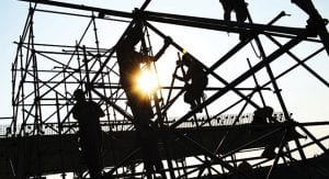 Silhouette of construction workers outside