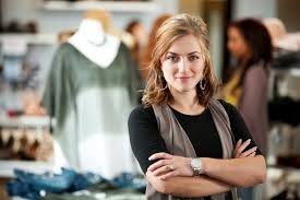 Confident business woman, arms folded, looking at the camera.