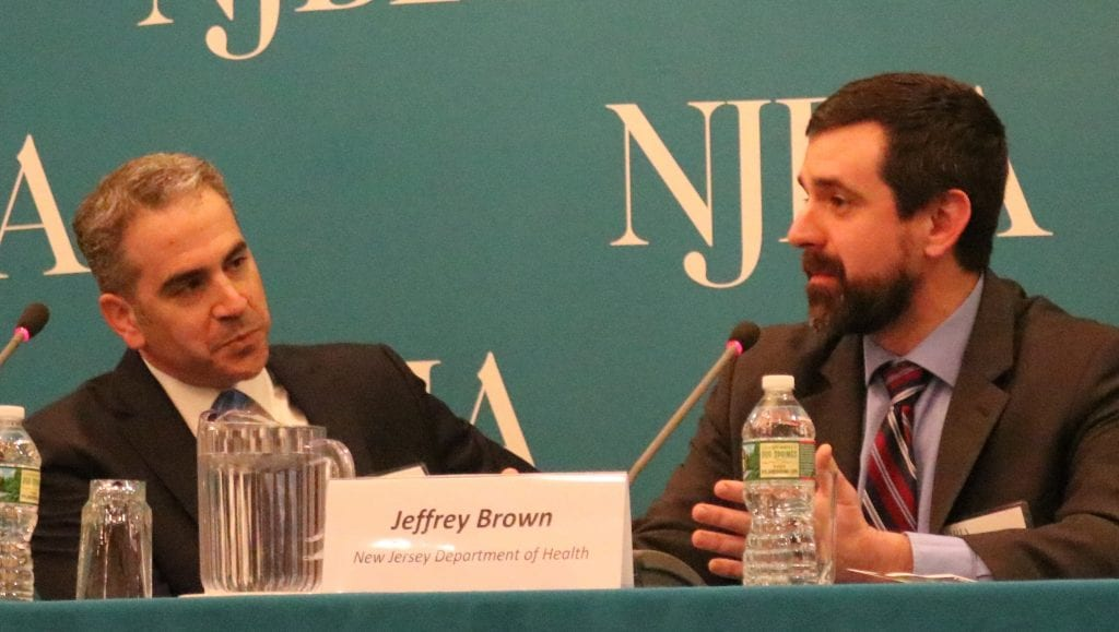 Bill Caruso (left) of Archer Law with Assistant Health Commissioner Jeff Brown at NJBIA's Cannibas seminar discussing policies on legalizing marijuana