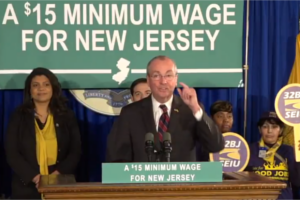 Gov. Phil Murphy at an earlier press conference calling for a $15 minimum wage