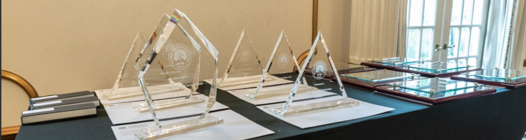 Glass award trophies sitting on an awards table