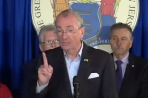 Gov. Phil Murphy gestures during a press conference on the budget.