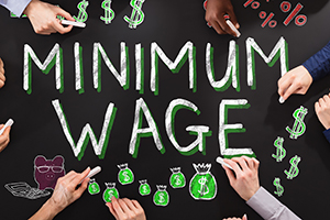 Minimum Wage written on a chalkboard