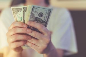 worker holding cash