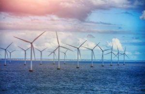 A field of windmills in the open ocean