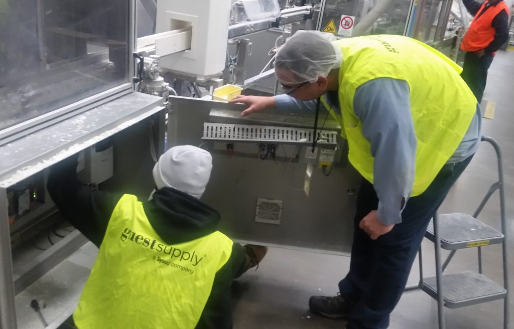 A student working at Gilchrist and Soames while receiving instruction from Plant Manager David Baron.