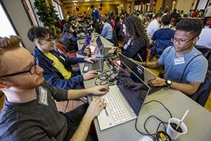 image of computer coders at Hackathon