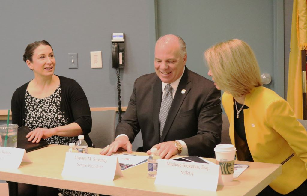 NJBIA Chief Government Affairs Officer Chrissy Buteas (left), Senate President Stephen Sweeney, NJBIA President and CEO Michele Siekerka at a table a