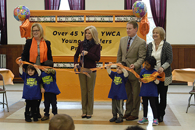 Dignitaries at ribbon cutting marking 45th anniversary of Young Wonders Child Development Center in Hamilton