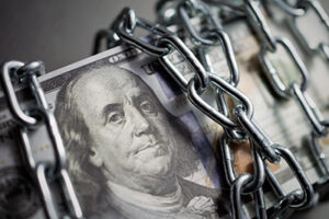 image of a bundle of dollars tied up with a chain