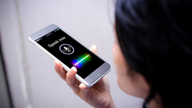 woman using voice search function on cell phone