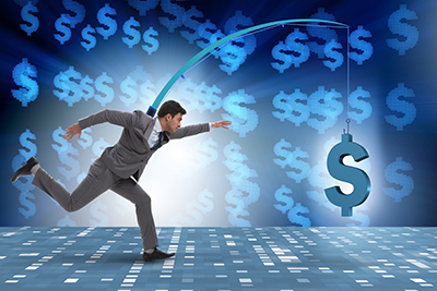 Businessman chasing money on fishing rod