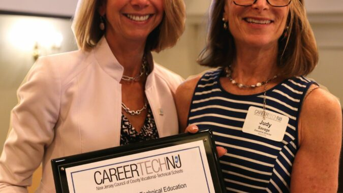 NJBIA's Michele Siekerka receives the CTE Leadership Award from Judy Savage, executive director of the New Jersey Council of County Vocational-Technical Schools