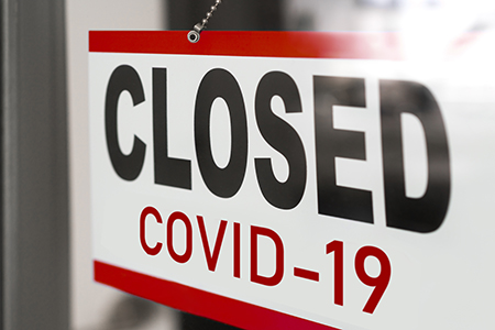 closed for COVID-19 sign on business door