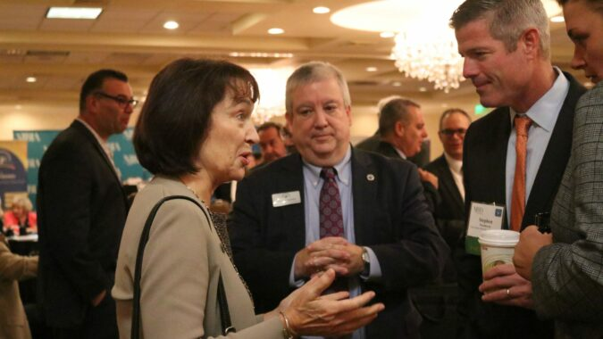 DEP Commissioner Catherine McCabe chats with attendees at Meet the Decision Makers breakfast