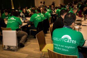 Fidelity volunteers in green T shirts