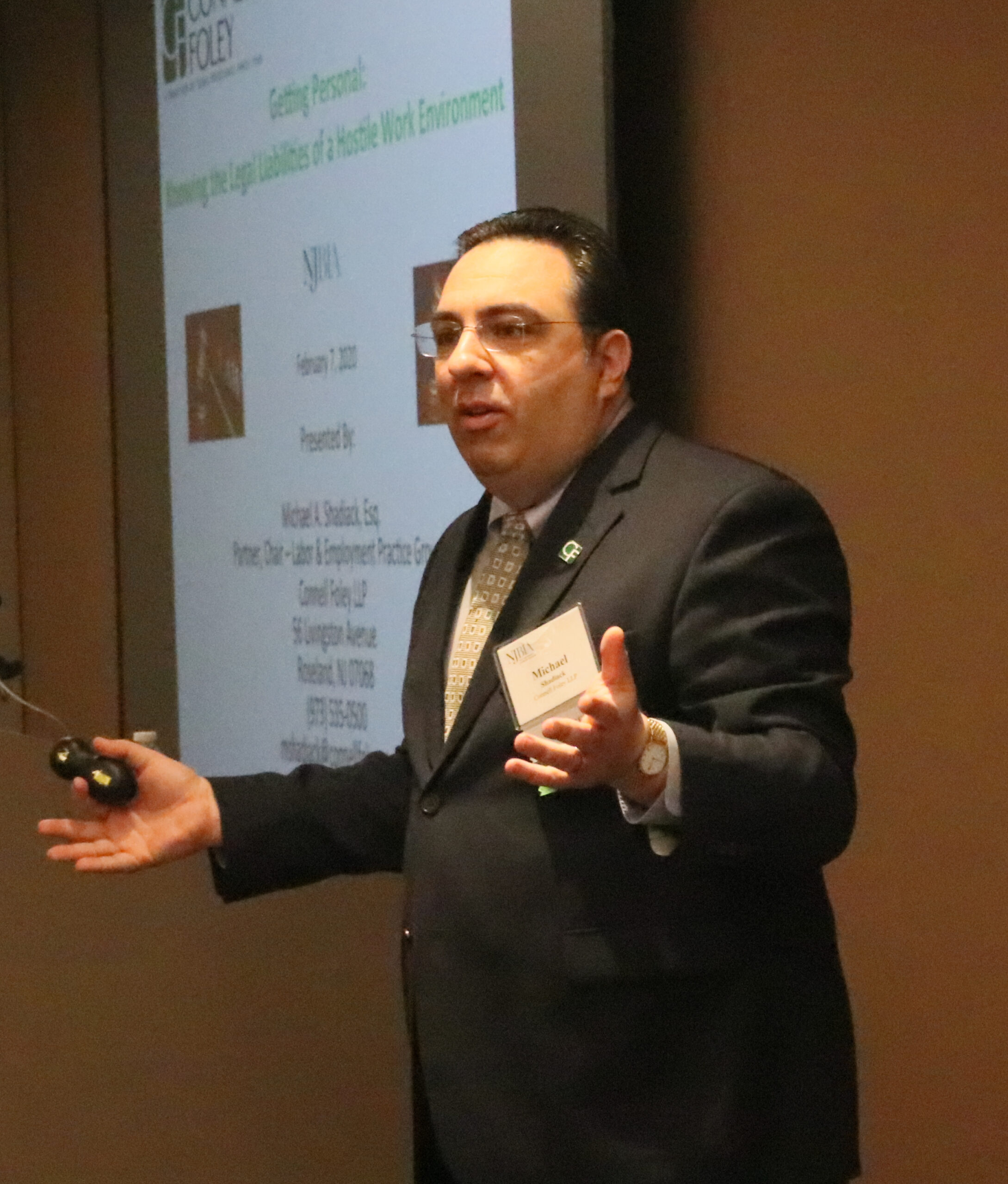 Attorney Michael Shadiack explaining policy pitfalls during a presentation on anti-harassment workplace policiesr.
