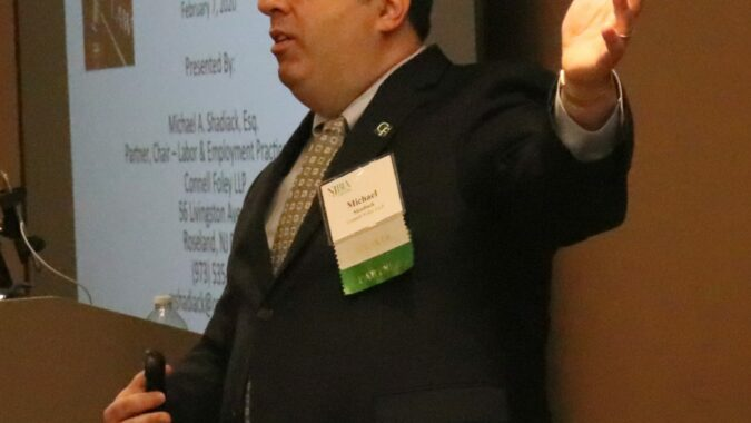 Attorney Michael Shadiack gestures during a presentation on anti-harassment policies in the workplace