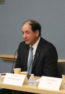 Sen. Joseph Vitale sitting at a table in front of a microphone at NJBIA headquartersat NJBIA's Health Affairs Committee June 3