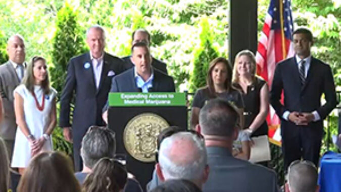 Photo of bill signing ceremony with Mike Honig