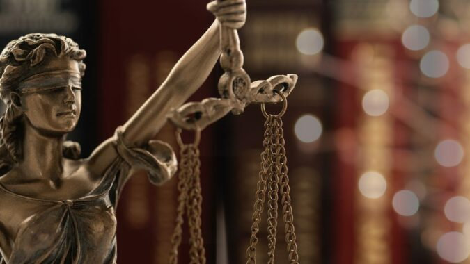 ustice law legal concept. statue of justice or lady justice with law books background.