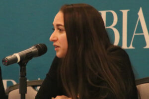 Ashley LeBrun of Archer Law responds to an audience question, speaking into a microphone during NJBIA's Leave Laws 3.0 seminar.