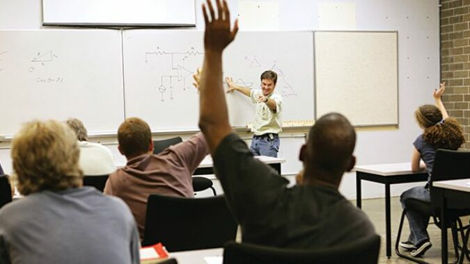 Teacher calling on a student in a classroom