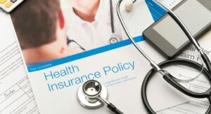 Healthcare policy booklet and stethoscope