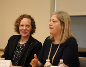 DEP Deputy Commissioner Deborah Mans (left) listens as BPU Chief of Staff Grace Power speaks to businesses at NJBIA's headquarters today.