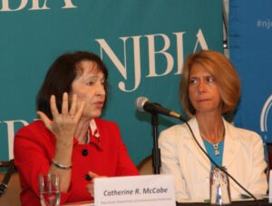 DEP Commissioner Catherine McCabe responds to a question at the June 19 Meet the Decision Makers Event as NJBIA President and CEO Michele Siekerka listens.