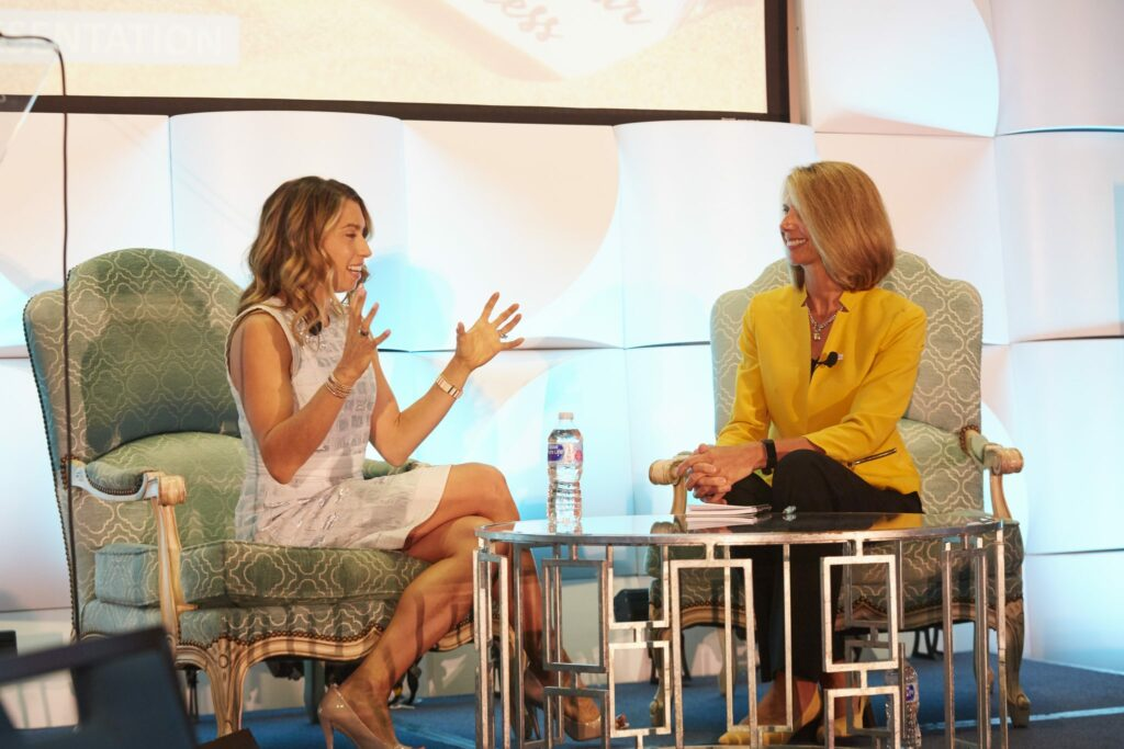 Jenny Fleiss, co-founder of Rent the Runway and Jetblack, sitting on stage with NJBIA's Michele Siekerka for a fireside chat-style interview before 500 attendees.he Women Business Leaders Forum Sept. 20.
