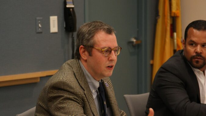 David Bander (left), executive director, Policy Office at New Jersey Department of Labor & Workforce Development, sat down with about 20 business people at NJBIA headquarters for a two-hour question and answer session about the new paid sick leave law. NJBIA's Michael Wallace listens in.