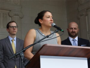NJBIA Chief Government Affairs Officer Christine Buteas speaks at a press conference following the vote.