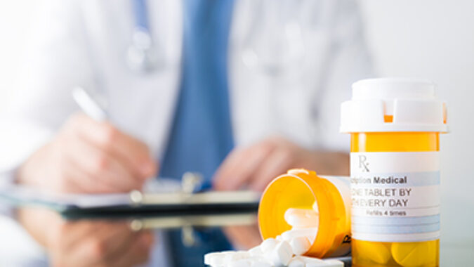 Image of pill bottles and Rx pad