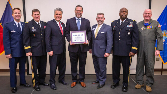Miguel Palmero, center, Executive Officer, Royal Caribbean International, holds the Employer Support of the Guard and Reserve (ESGR) Seven Seals Award presented to Royal Caribbean International during a ceremony at the Joint Military and Family Assistance Center in Bordentown, N.J., May 17, 2019. Also pictured are, left to right, Col. John M. Cosgrove, Commander, 108th Wing, New Jersey Air National Guard; Maj. Gen. Mark W. Palzer, Commanding General, 99th Readiness Division, Army Reserve; Don Tretola, State Chair, New Jersey Employer Support of the Guard and Reserve; Bruce Townsend, Chief, Employer Outreach, ESGR; Brig. Gen. Jemal J. Beale, The Adjutant General of New Jersey, and Col. Thomas O. Pemberton, Commander, 514th Air Mobility Wing, Air Force Reserve Command. ESGR develops and promotes a supportive work environments for Guard and Reserve service members through outreach, recognition, and educational opportunities that increase awareness of applicable laws, as well as resolves employer conflicts between service members and their employers. (New Jersey National Guard photo by Mark C. Olsen)