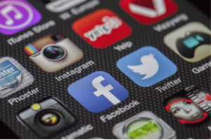 Social media apps on a smart phone screen