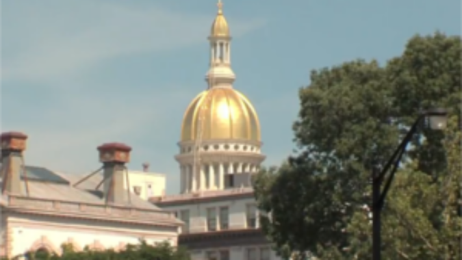 Exterior shot of NJ State House with gold dome.