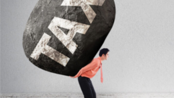 Man with a boulder on his back that says TAX