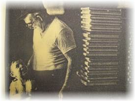 Louis Gregorencsics and his grandfather at the bookbindery circa 1977.