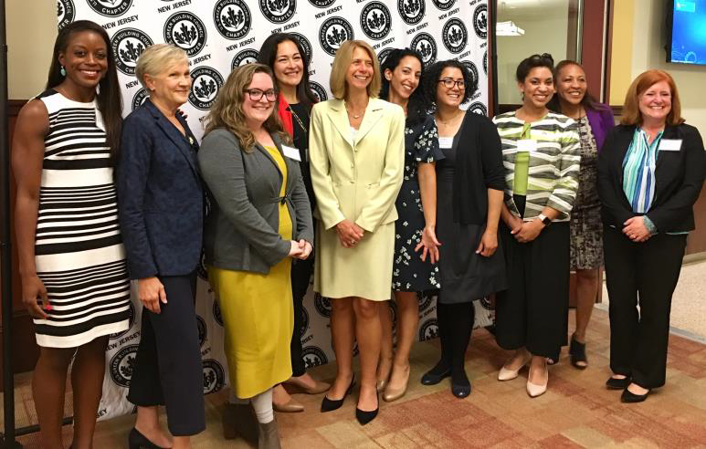 Photo of event participants:  (Pictured left to right: Jessica Ford; Jayne Spector; Casey Cullen-Woods; Monika Serrano-Reidlinger; Michele Siekerka; Lauren Brust Moss; Nathaly Agosto Filión; Gail Lalla; Faith Taylor; and Amy Tuininga.)