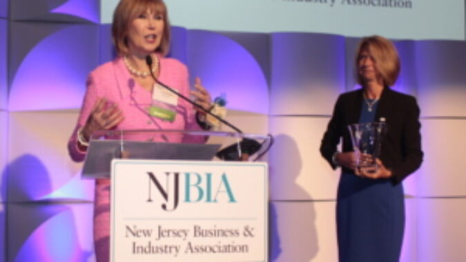 Linda Bowsden speaking with NJBIA President and CEO Michele Siekerka standing near by