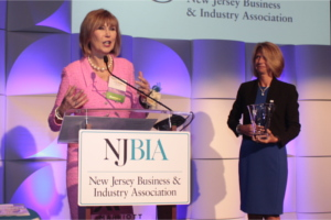 Linda Bowden speaking with NJBIA President and CEO Michele Siekerka standing near by