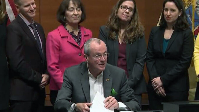 Governor Murphy signing EO 100
