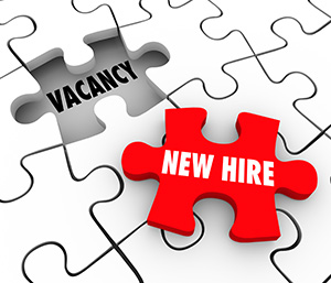 image showing puzzle pieces with the words 'vacancy' and 'new hire'
