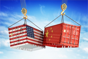 Shipping containers with American flag and Chinese flag being hoisted in the air